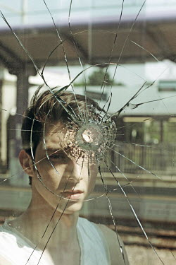 Giovan Battista D'Achille YOUNG MAN BEHIND BULLET HOLE IN GLASS Men