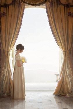 Lee Avison regency woman standing at a floor to ceiling window Women