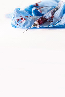 Stephen Mulcahey syringe and needle lying on bloody gloves Miscellaneous Objects