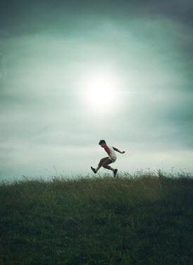 Mark Owen YOUNG TEENAGE BOY JUMPING IN FIELD Children