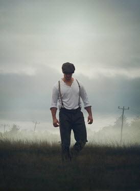 Mark Owen VINTAGE MAN WALKING IN CLOUDY FIELD Men