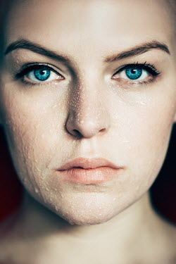 Rekha Garton YOUNG BLUE EYED WOMAN WITH WET FACE Women