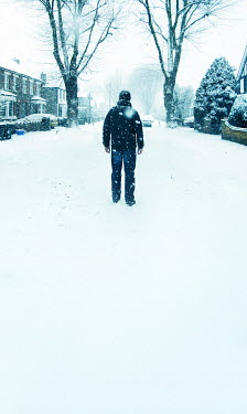 Stephen Mulcahey man standing in snowy suburban street Men