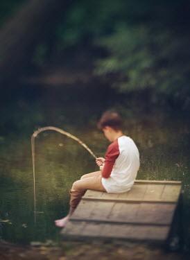Mark Owen YOUNG TEENAGE BOY FISHING BY COUNTRY LAKE Children