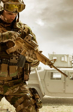 CollaborationJS special forces soldier checking his assault rifle Men