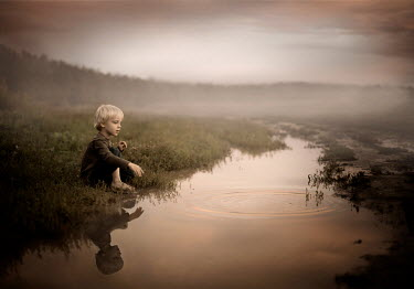 Sveta Butko LITTLE BLOND BOY SITTING BY PUDDLE IN FIELD Children