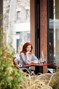 Chris Reeve YOUNG WOMAN SITTING IN OUTSIDE CAFE Women