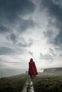 Stephen Mulcahey woman in cape walking by white cliffs of dover Women