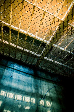 Trevor Payne CRACKED STONE FLOOR OF PRISON CELL Interiors/Rooms