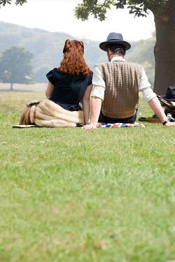 Lee Avison 1940s couple having picnic in countryside Couples