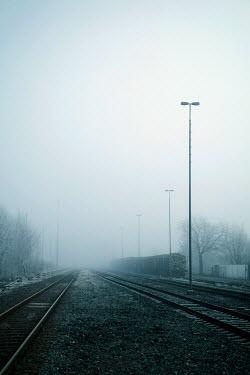 Carmen Spitznagel TRAIN ON MISTY RAILWAY TRACKS Railways/Trains