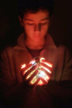 Paulo Dias TEENAGE BOY HOLDING FAIRYLIGHTS Children