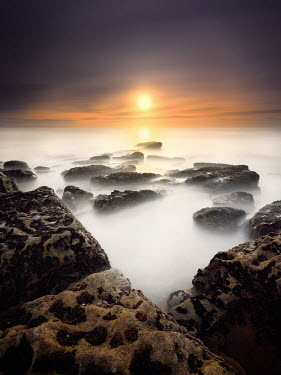 Paulo Dias ROCKS IN MISTY SEA AT SUNSET Seascapes/Beaches