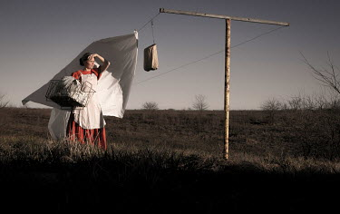 Rodney Harvey YOUNG HISTORICAL WOMAN BY WASHING LINE Women