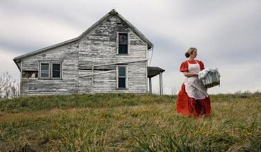 Rodney Harvey HISTORICAL WOMAN BY WEATHERBOARD HOUSE Women