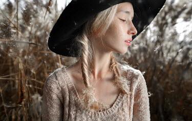 Igor Burba YOUNG BLONDE WOMAN WEARING HAT IN COUNTRY Women