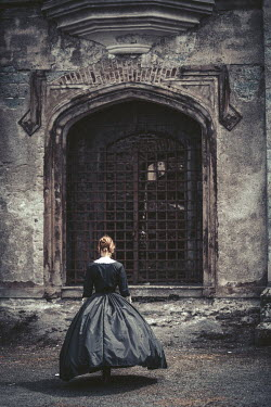 Magdalena Russocka VICTORIAN WOMAN WITH PLAITS BY CASTLE DOOR Women