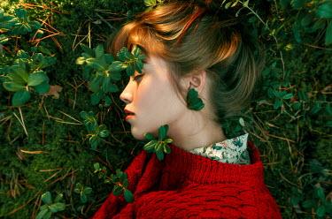 Igor Burba YOUNG WOMAN LYING ON LEAFY FIELD Women