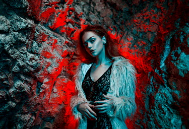 Igor Burba WOMAN WEARING FUR COAT IN ROCKY CAVE Women