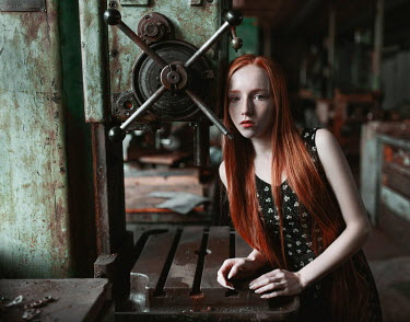 Igor Burba YOUNG WOMAN WITH RED HAIR IN WORKSHOP Women