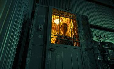 Igor Burba YOUNG WOMAN IN OLD INDUSTRIAL ELEVATOR Women
