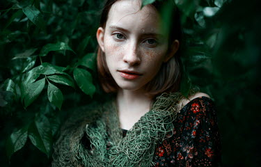 Igor Burba YOUNG WOMAN WITH FRECKLES UNDER WET LEAVES Women