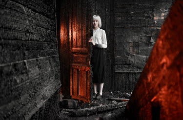 Igor Burba YOUNG BLONDE WOMAN IN DERELICT BURNT ROOM Women