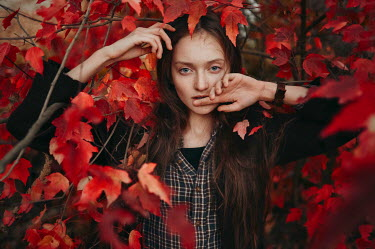 Igor Burba YOUNG BRUNETTE WOMAN BY RED AUTUMN LEAVES Women