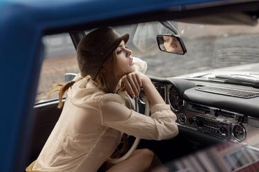 Maxim Guselnikov VINTAGE WOMAN LEANING ON CAR DASHBOARD Women