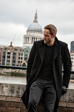 Nik Keevil MAN WEARING BLACK COAT BY LONDON RIVER Men