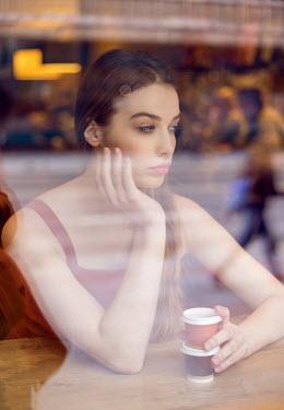 Nina Masic YOUNG BRUNETTE WOMAN IN COFFEE SHOP Women