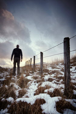 Andy & Michelle Kerry MAN IN FIELD BY BARBED WIRE FENCE Men
