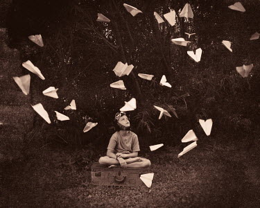 Erika Masterson LITTLE BOY UNDER FLOATING PAPER AEROPLANES Children