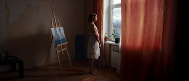 Efim Shevchenko YOUNG WOMAN BY EASEL IN SHADOWY ROOM Women