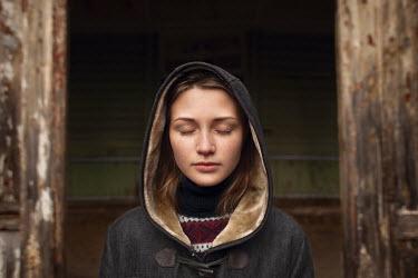 Efim Shevchenko YOUNG WOMAN WEARING COAT WITH HOOD Women