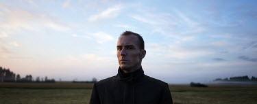 Efim Shevchenko MAN WEARING COAT IN COUNTRYSIDE Men