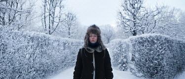Efim Shevchenko YOUNG WOMAN WEARING FUR HAT IN SNOWY GARDEN Women