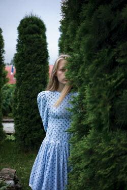 Efim Shevchenko YOUNG WOMAN HIDING BEHIND GARDEN HEDGE Women