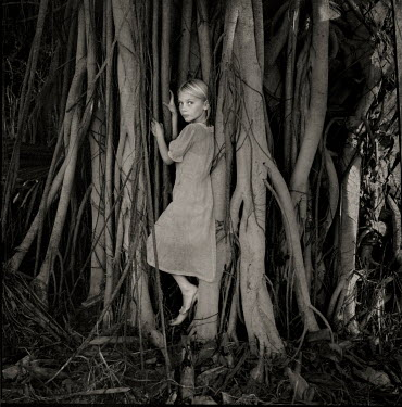 Erika Masterson YOUNG GIRL NEXT TO TREE ROOTS Children