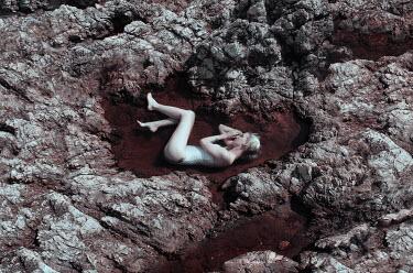 Ciro Galluccio WOMAN LYING IN ROCK POOL Women