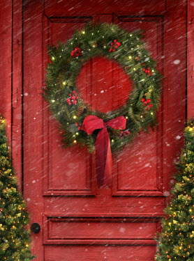 Sandra Cunningham Christmas wreath on red door in snow Houses