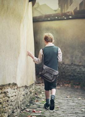 Mark Owen 1940S SCHOOL BOY WALKING ON COBBLED STREET Children