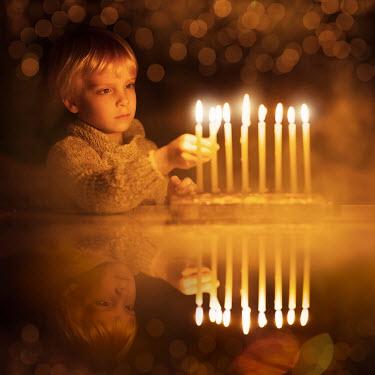 Sveta Butko LITTLE BLOND BOY LIGHTING CANDLES Children