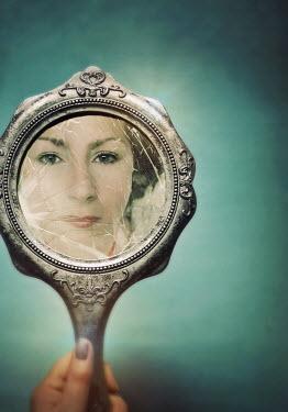 Lyn Randle WOMAN REFLECTED IN BROKEN HAND MIRROR Women