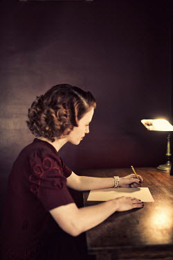 Elisabeth Ansley YOUNG RETRO WOMAN WRITING LETTER ON DESK Women
