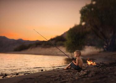 Lisa Holloway LITTLE BOY FISHING ON BEACH AT SUNSET Children