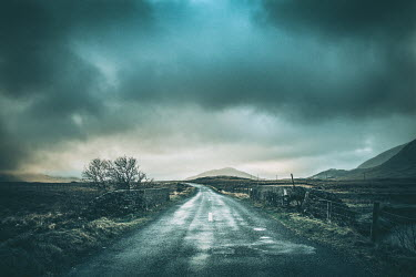 Magdalena Russocka COUNTRY ROAD THROUGH CLOUDY MOUNTAIN RANGE Roads