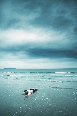 Magdalena Russocka MAN WITH DARK HAIR WASHED UP ON BEACH Men