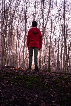 Stephen Mulcahey boy wearing red hoodie in the forest Children