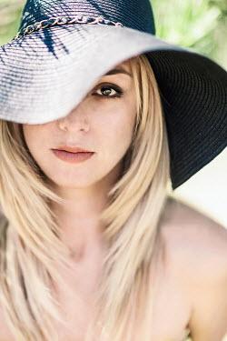 Evelina Kremsdorf YOUNG BLONDE WOMAN WEARING SUN HAT Women